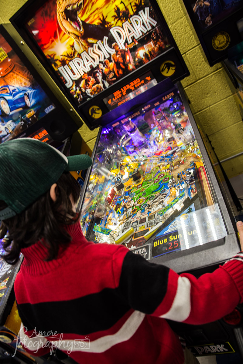 Kid Playing Pinball image