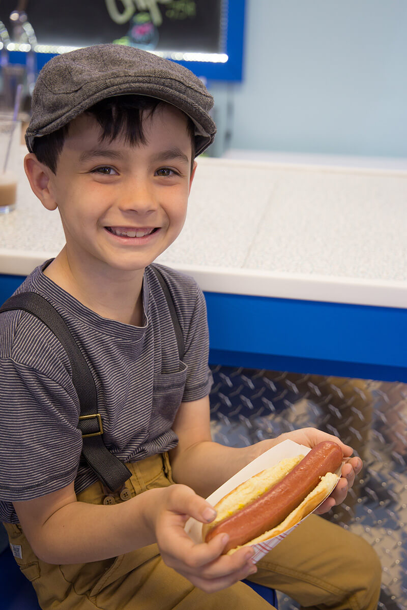 Image of a Kid With a Fresh Hot Dog