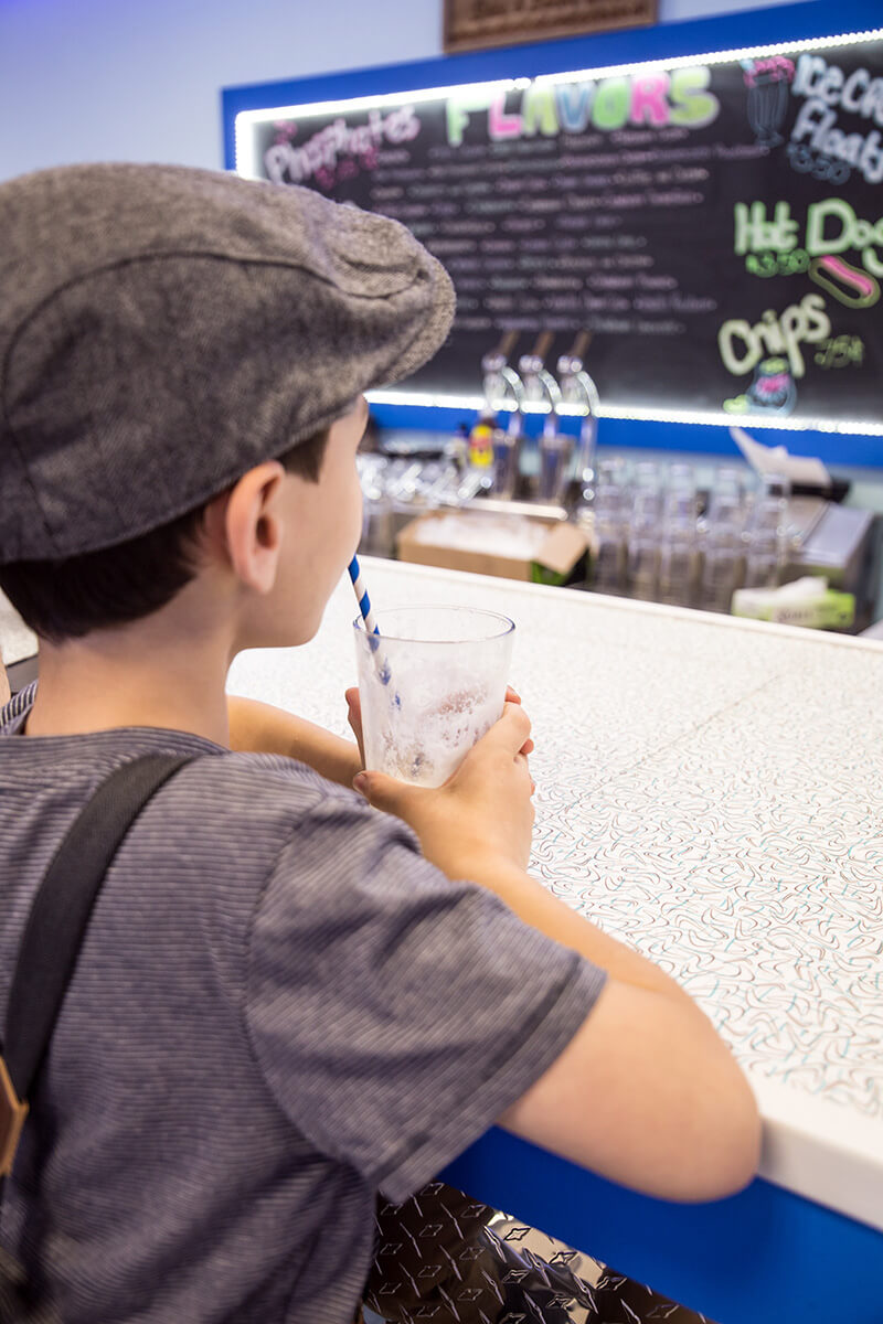 Image of a Kid Sipping on an Egg Cream