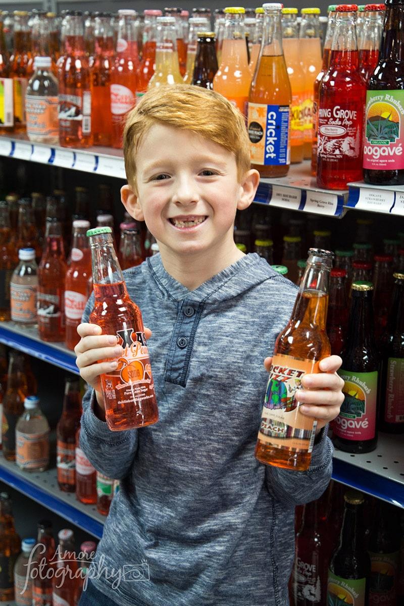 Image of a Kid Choosing Favorite Brands of Craft Soda